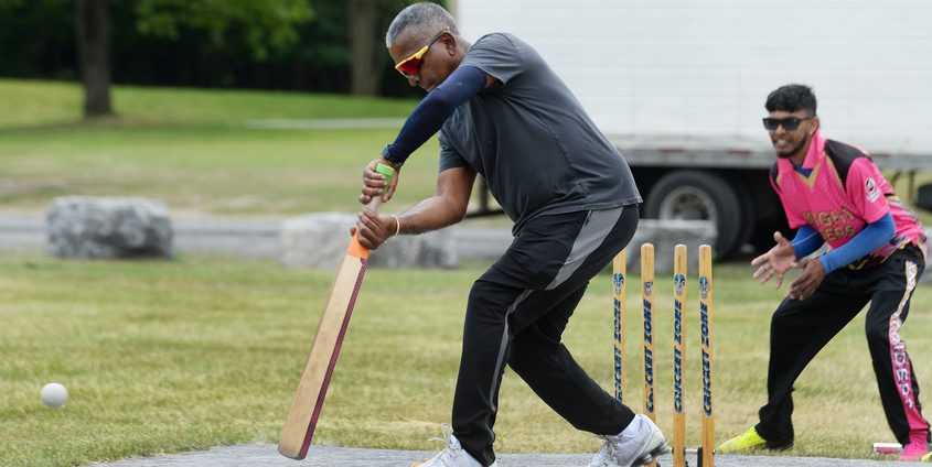 Batsman and President Onkar Singh, of Schenectady, up to bat with keeper Ryan Persaud, of Schenectady.
