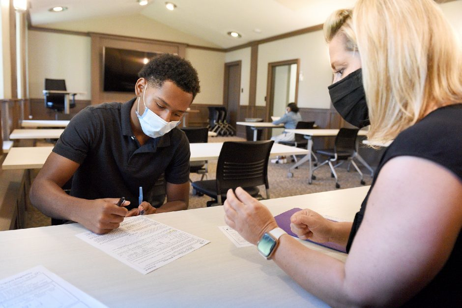 Jamie Toomer, 16, of Schenectady, and a junior at Bishop Maginn High School, interviews for a summer job with Schenectady County Job Training Agency Information Processing Specialist Marlo Valachovic for their summer youth employment programon Thursday.