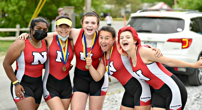 Niskayuna rowers Jessica Arul, Samantha Rowden, Anna Vinciguerra, Caylin Schneiderand Kylie VanPatten show off their medals Sunday afternoon, the second day of competition at the New York State Invitational at Fish Creek.