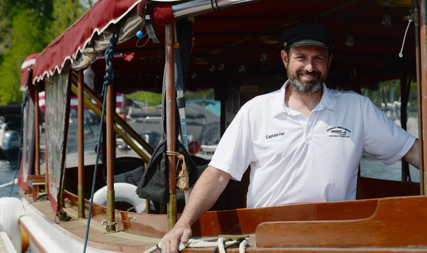 Owner of Adirondack Cruise and Charter Hal Raven with one of his boats docked on Saratoga Lake in Saratoga Springs recently.