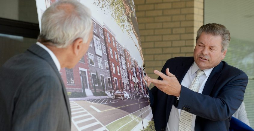 Ken Kearney, right, owner of Kearney Realty Group, explains the proposed Glove City Lofts apartments that would be constructed at the site of the former Frontier Call Center on Church Street adjacent to Gloversville City Hall. Also pictured is GloversvilleMayor Vince DeSantis. The announcement was made Tuesday at the call center site.