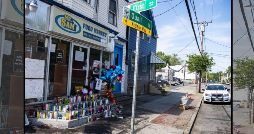 A large memorial covers the front of Mr. Sam Food Market at First and Quail streets in Albany on Tuesday.