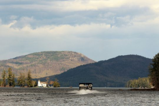 A boat heads out on the water at Brant Lake in Warren County.