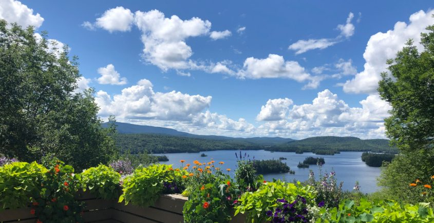 Blue Mountain Lake is on full display from an overlook at Adirondack Experience, The Museum on Blue Mountain Lake.