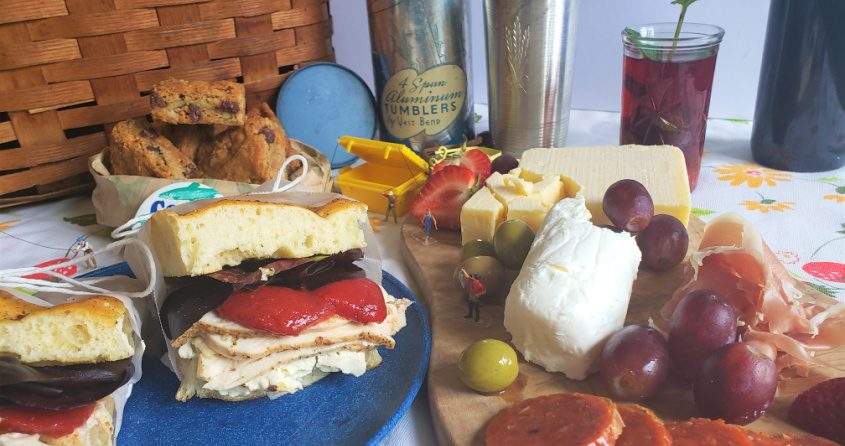 A picnic basket full of focaccia sandwiches, a charcuterie board, sangria and blondies is perfect for an afternoon boat ride with friends.