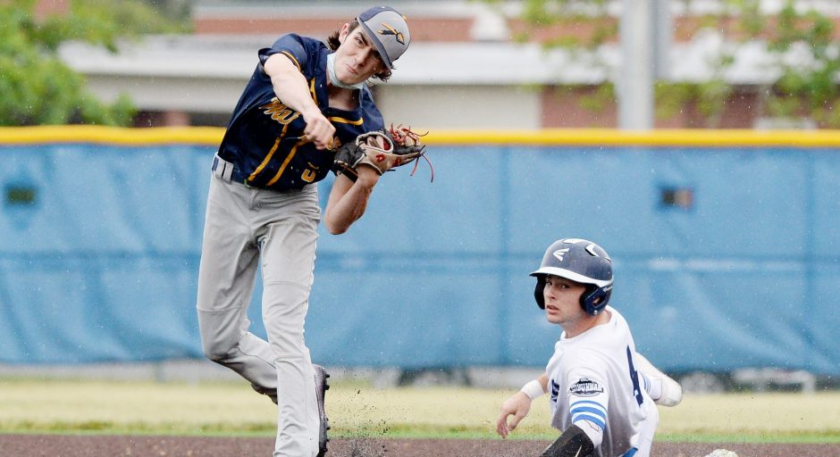 Averill Park's Steven Koval throws to first base after forcing out Saratoga Springs' Ryan Dolan at second base during Wednesday's Suburban Council baseball game at East Side Rec in Saratoga Springs.