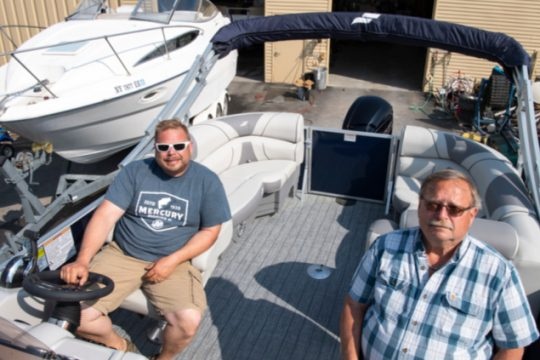 John and Alan Andersen of Andersen Boat in Burnt Hills sit in one of their latest sales earlier t his month.
