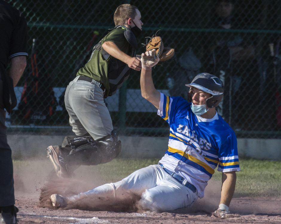 Galway's Anthony Powers slides safely into home plate in front of Middleburgh catcher Matt Croote on Thursday.
