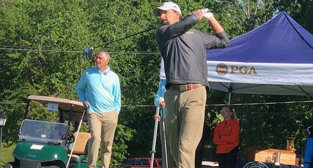 Brad Gardner, head pro at The Edison Club, tees off during the Challenge Cup at Schuyler Meadows Club. The pros beat the amateurs for the first time since 2014. (Bob Weiner photo)