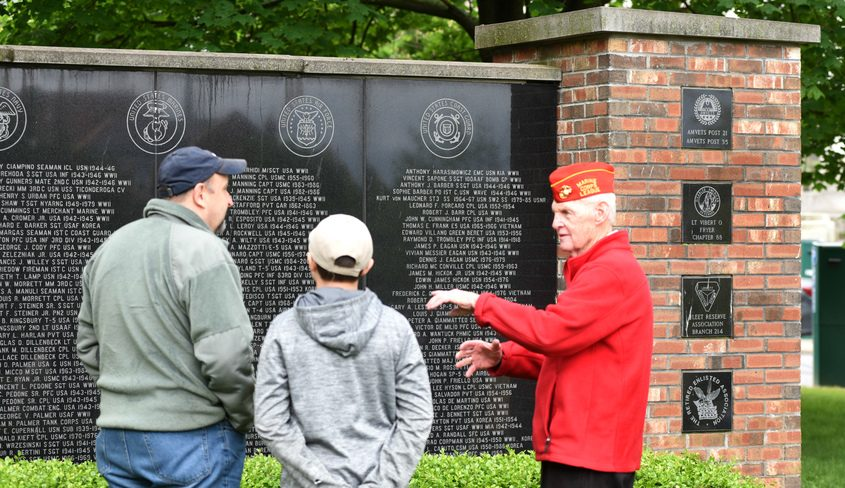John Manning, 84, of Rotterdam, USMC veteran, right, talks to Air National Guard member Michael Spina, Sr, left, and his son, Michael Spina, Jr, 14, at one of the veteran memorials prior to Monday morning's Memorial Day service at Veteran's Park on State Street.