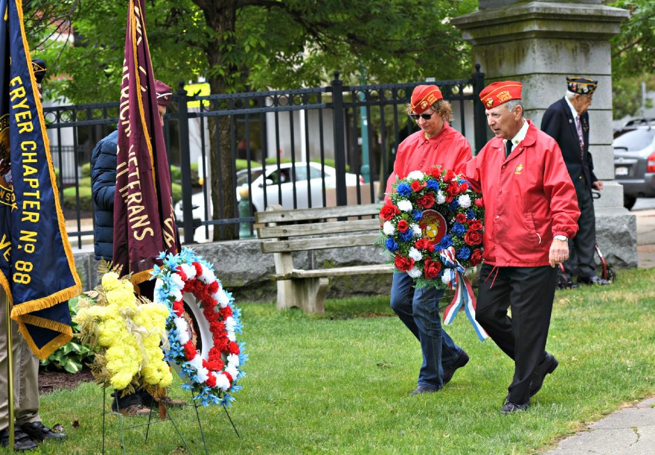Former USMC Cpl.Margaret Zotta of Rotterdam, left, and Michael Carhidi, former USMC Sgt., bring the Marine Corps wreath to the front of the veterans memorial during Monday morning's Memorial Day service at Veterans Park on State Street in Schenectady. May, 31, 2021.