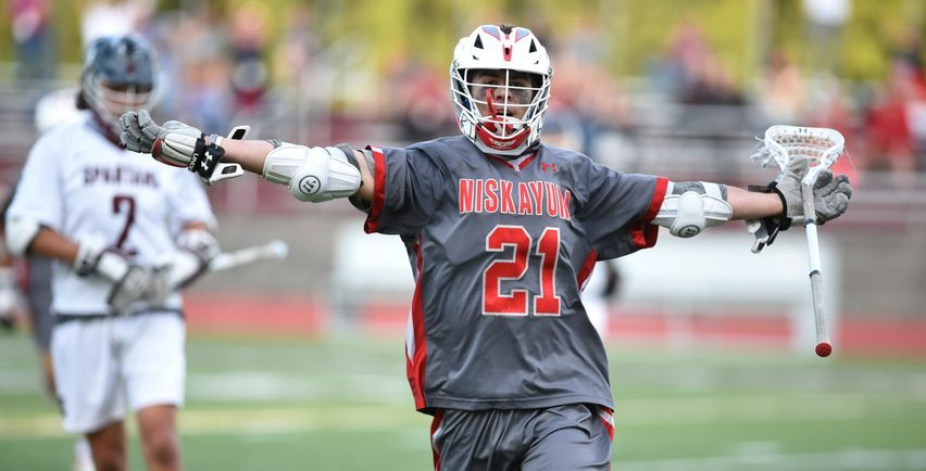 Niskayuna's Brock Behrman celebrates after scoring one of his seven goals in Tuesday's Suburban Council lacrosse game against Burnt Hills-Ballston Lake at Centennial Field.