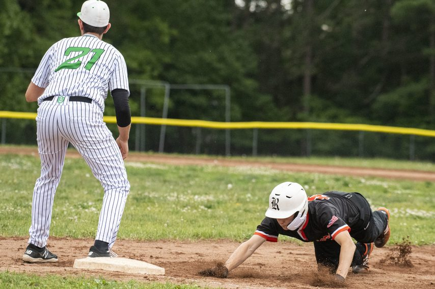 Zach Ridgeway of Mohonasen dives back to first base before Thomas Pascarella of Schalmont applies a tag in Thursday's Colonial Council baseball game at Schalmont High School.