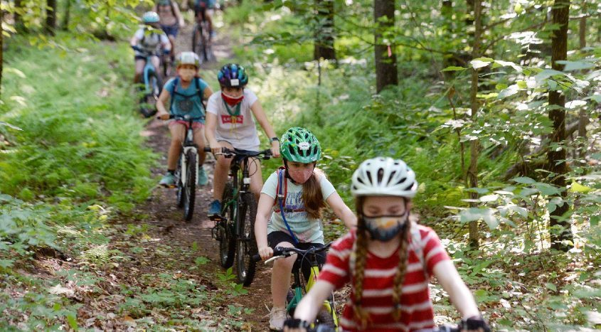 Saratoga Shredders girls, in the Mayflies group, mountain bike down a trail during practice at the Saratoga County Kalabus Perry trails in the Wilton Wildlife Preserve and Park in Wilton on Friday.