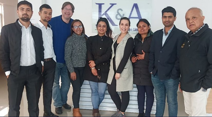 John Blowers, vice president of operations, third from left, and Rishi Sharma, director of Nepal operations, far right, stand with members of K&A's Nepal operations and HR teams in Kathmandu in February 2020.