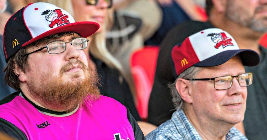 Amsterdam Mohawks baseball fans Chris Luft, left, and Rodney Luft watch the home opener at Shuttleworth Park on Friday, June 4, 2021.