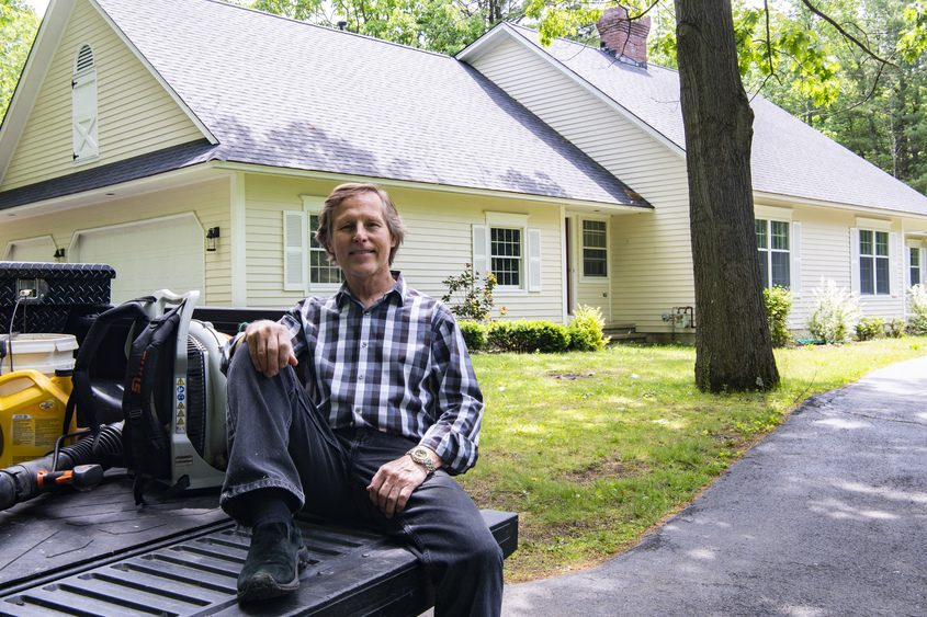 Robert Szymczak sits outside his late father's house on Lake Hill Road inEast Glenville on Wednesday, June 2, 2021. The house sold for more than asking price just three days after going on the market.