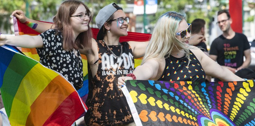Abby Carpenter, left, Landon Butler, and November Teague, all of Schenectady attend  the Schenectady Pride event at Gateway Plaza in Schenectady Saturday