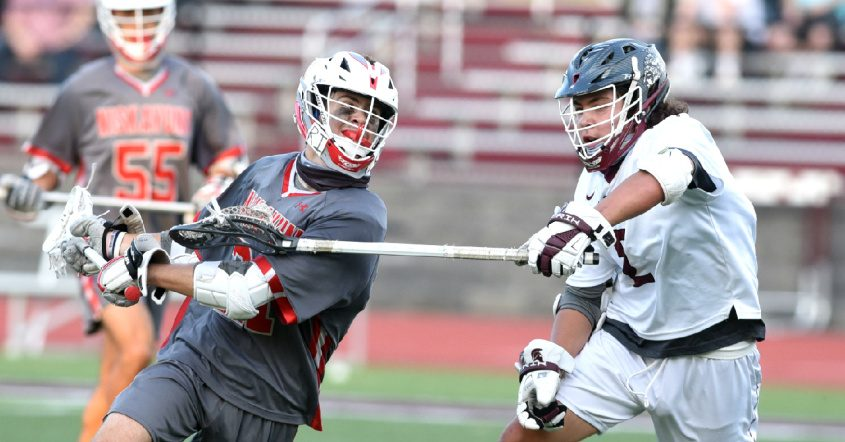 Niskayuna's Brock Behrman turns and fires on goal in front of Burnt Hills-Ballston Lake's Colden Swisher a June 1 boys' lacrosse game at Burnt Hills-Ballston Lake High School.