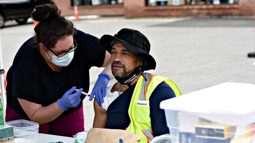 Taylor Taranto, RN, of Schenectady, left,  gives Larry Lee of Schenectady a Johnson and Johnson COVID-19 vaccine Thursday afternoon June 3 at the Schenectady Inner City Mission.
