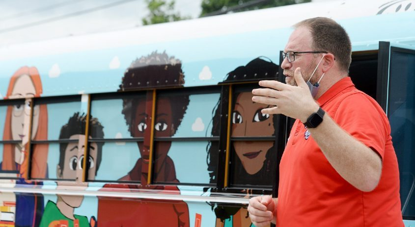 Michael Sheridan, Oneida Middle School's integration media specialist, speaks outside the Schenectady City School District's bookmobile, whichwill start visiting locations Wednesday. Sheridan spoke at Mont Pleasant Middle School on Friday.