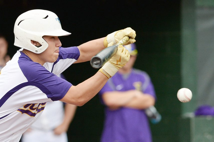 Amsterdam's Ryan Reagan drops down a bunt during Tuesday's Section II Class A playoff game against Gloversville at Shuttleworth Park in Amsterdam.