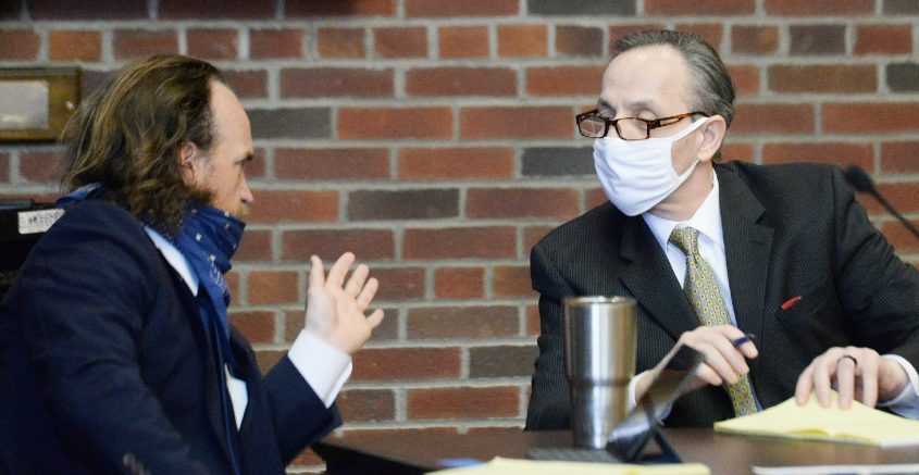 Georgios Kakavelos, right, listens to his attorney, Kevin K. O'Brien,at the beginning of his murder trial in Saratoga County Court on May 12.