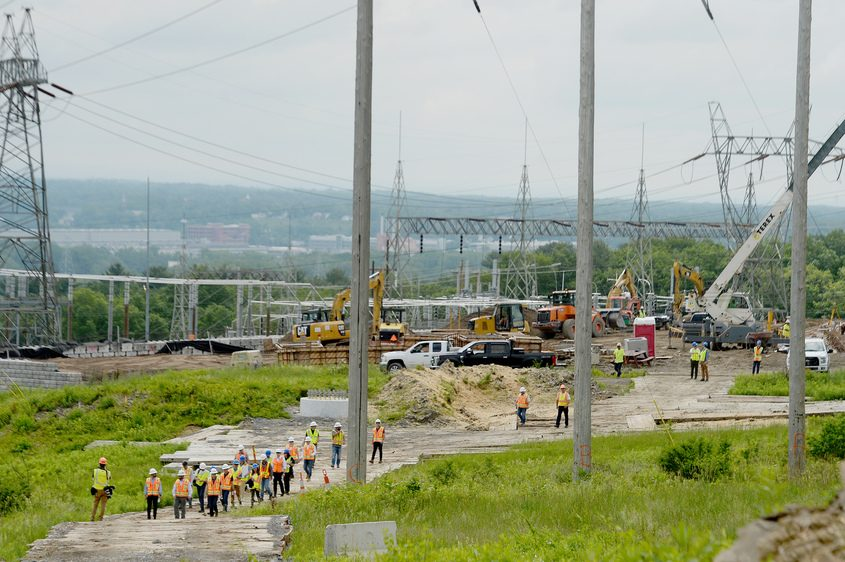 Officials and visitors inspect the substation and power line work underway off Gordon Road in Rotterdam on Wednesday, June 9, 2021.