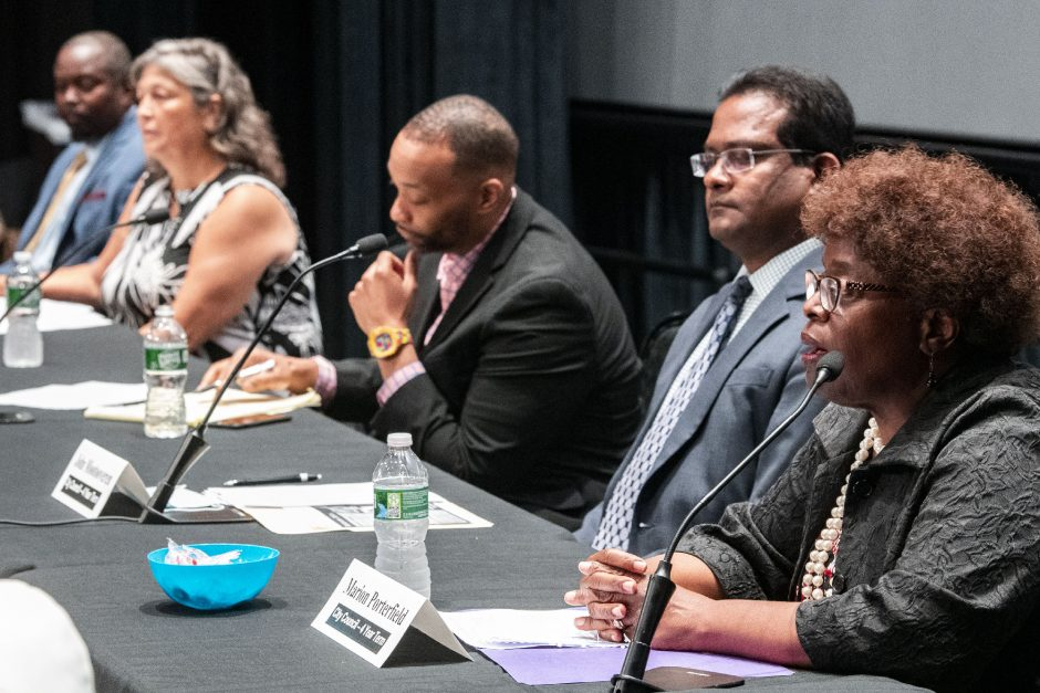 City Council candidate and current councilwoman Marion Porterfield, right, makes her opening statement at a candidates forum in the GE Theatre at Proctors Wednesday. Listening, from left, are Haileab Samuel, Doreen DiToro, Damonni Farley and John Mootooveren.