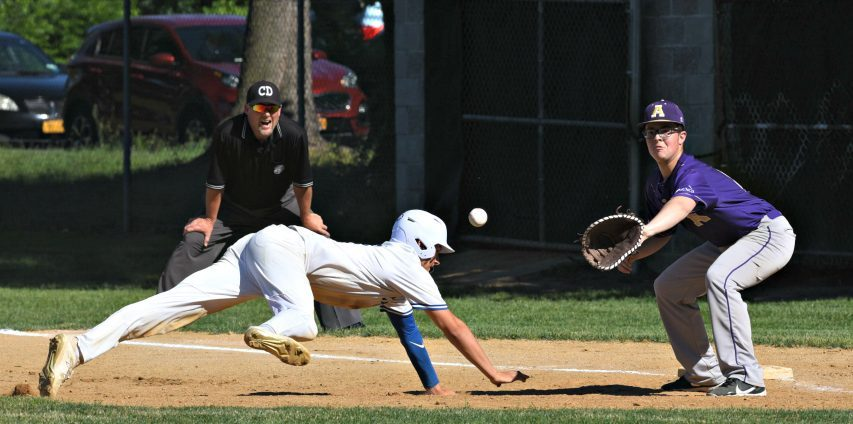 La Salle base runner Eddie Yamin dives back to first base as Amsterdam's Kyle Bottisti awaits the throw Thursday afternoon during the Section II Class A quarterfinal in Troy.