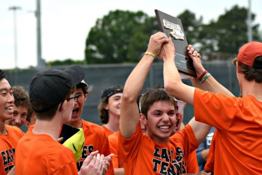 The Bethlehem Eagles hoist the Section II title plaque Friday afternoon after defeating Saratoga Springs 5-4 at the Section II Class AA boys' tennis championships at Shenendehowa High School.