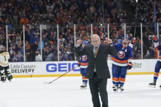 New York Islanders coach Barry Trotz celebrates on the ice with the team after Game 6 of an NHL Stanley Cup second-round playoff series against the Boston Bruins on Wednesday in Uniondale. The Islanders eliminated the Bruins with a 6-2 victory. (Frank Franklin II/The Associated Press)
