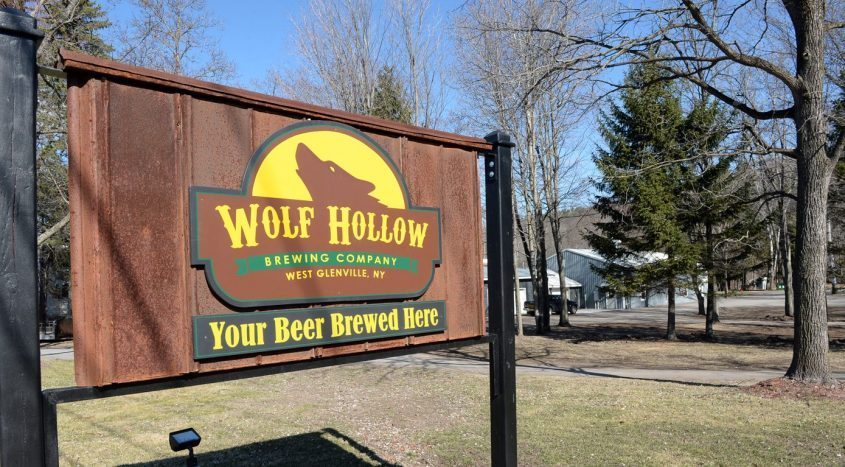 The sign at the entrance to Wolf Hollow Brewing Company located on Route 5 (Amsterdam Road) is seen.