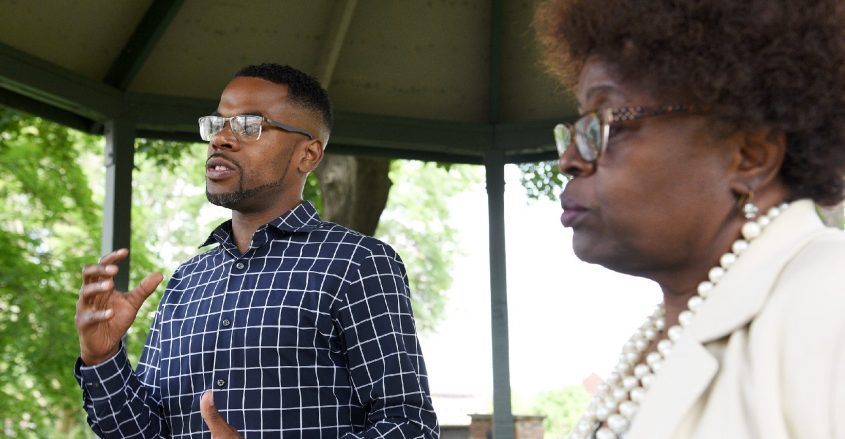 Candidate for Schenectady County Legislature District #1 Omar Sterling McGill, left, speaksnext to Schenectady CityCouncilwoman Marion Poterfieldduring their Get Out The Voterally at Veteran's Park in Schenectady on Saturday, June 12, 2021.