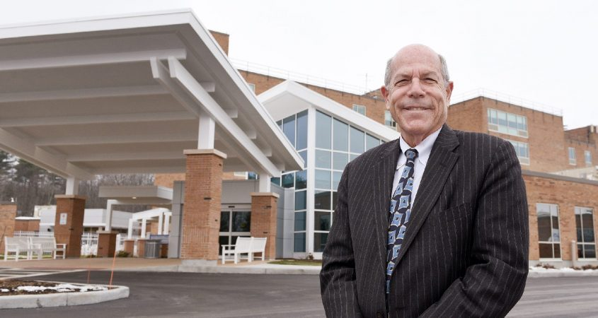 Shaker Place Rehabilitation and Nursing Center Executive Director Larry I. Slatky stands in front of its new lobby in Latham on Friday, January 15, 2021.