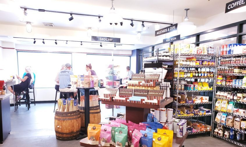 Putnam Market's interior features plenty of specialty groceries and eating area for those dining in.