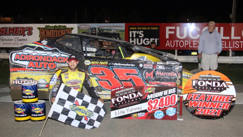 Mike Mahaney celebrates in victory lane after winning Saturday's Sunoco Modified feature at Fonda Speedway. (Photo courtesy Jeff Karabin)