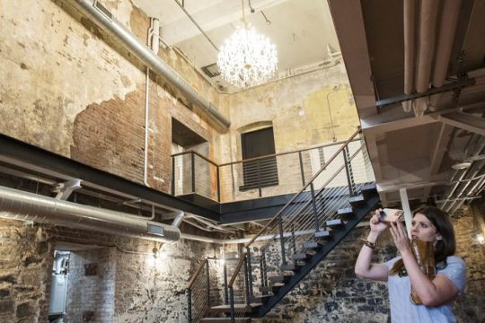 Redburn Development Partners Executive Vice President Elizabeth Young Jojo takes a photo of Seasons Catering's new wedding venue at 136 Broadwayon Tuesday.