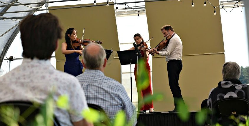 The Chamber Music Society of Lincoln Center season at SPACopened Sunday with concertsat Pitney Meadows in Saratoga Springs, featuring, on stage, Stella Chen, left, Bella Hristova, center, and Misha Amory.