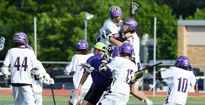 The Johnstown boys' lacrosse team celebrates after beating Schuylerville in overtime for the Section II Class D championship on Tuesday.