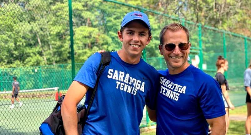 Saratoga Springs senior Nick Grosso, left, stands with Blue Streaks tennis coach Tim O'Brien after winning the Section II boys' tennis singles title Tuesday afternoon at Central Park. (Photo provided)