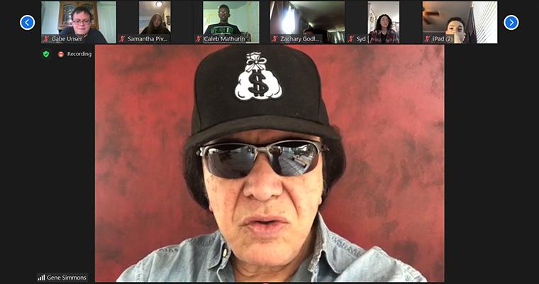 A screen shot shows Gene Simmons as he speaks to a Schalmont High School class.