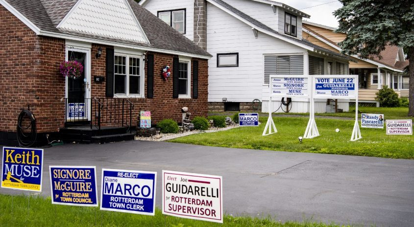 Campaign signs sit on the front lawns of 846 and 842 Curry Road in Rotterdam Friday.