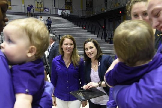 Lauren, center left, and Colleen Mullen, center right, watch as UAlbany women's basketball players hold their twin sons Callan and Brennan during Colleen's introductory press conference as UAlbany coach in 2018.