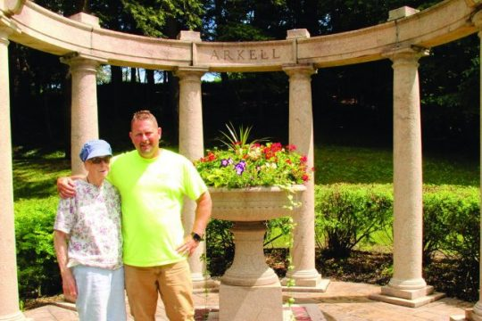 Canajoharie Falls Cemetery Superintendent Larkin Kirby poses with his mother, Barbara, at the Arkell plot.