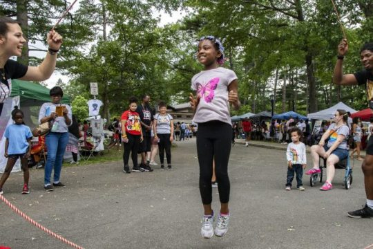 Nia Zwana, 9, of East Greenbush double dutches at the 21st Annual Juneteenth celebration in Schenectady's Central Park with Tiana Williamson, left, and Johnny McIntosh manning the ropes on Saturday, June 19, 2021.