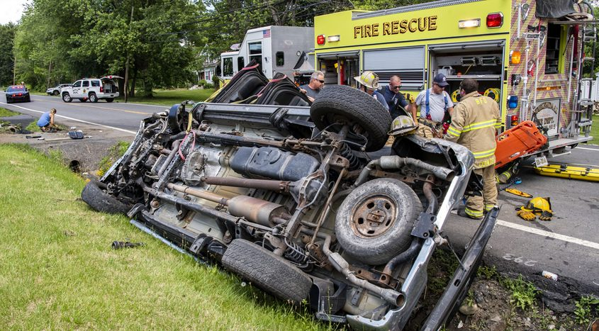 The driver of this pick up truck is extricated from his vehicle by Beukendaal firefighters after losing control on Sacandaga Road in Glenville Sunday.