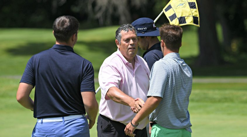 Paul Pratico shakes hands with Kyle Adams, right, after winning the Schenectady Classic on Sunday Schenectady Municipal Golf Course. Griffith Hunter is at the left.