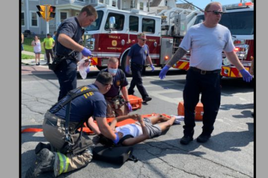 Schenectady firefighters tend to the boy at the scene Monday afternoon.