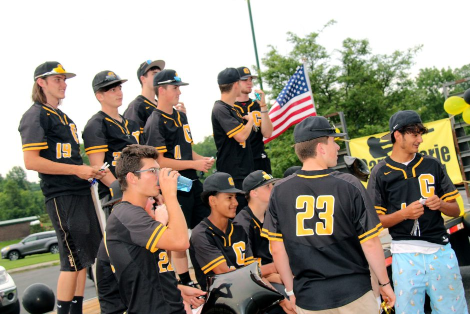 The Canjaoharie baseball team boards their float at the outset of Monday's parade held in honor of last week's sectional championship win.